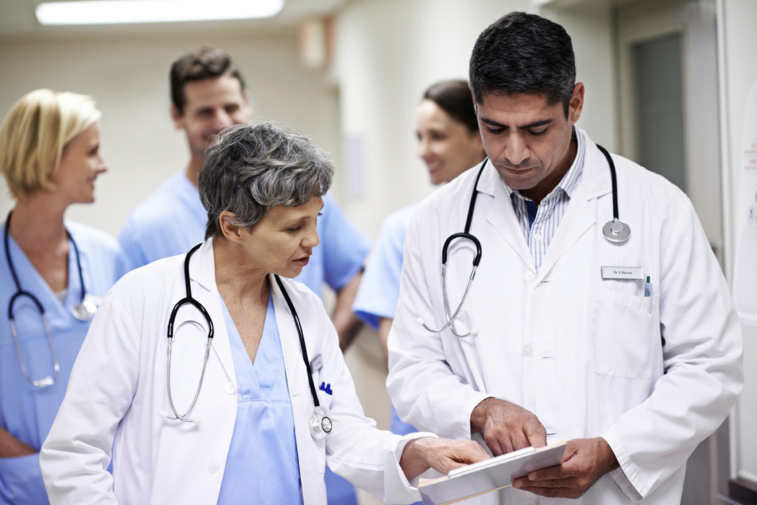 Two doctors discussing patient's medical chart