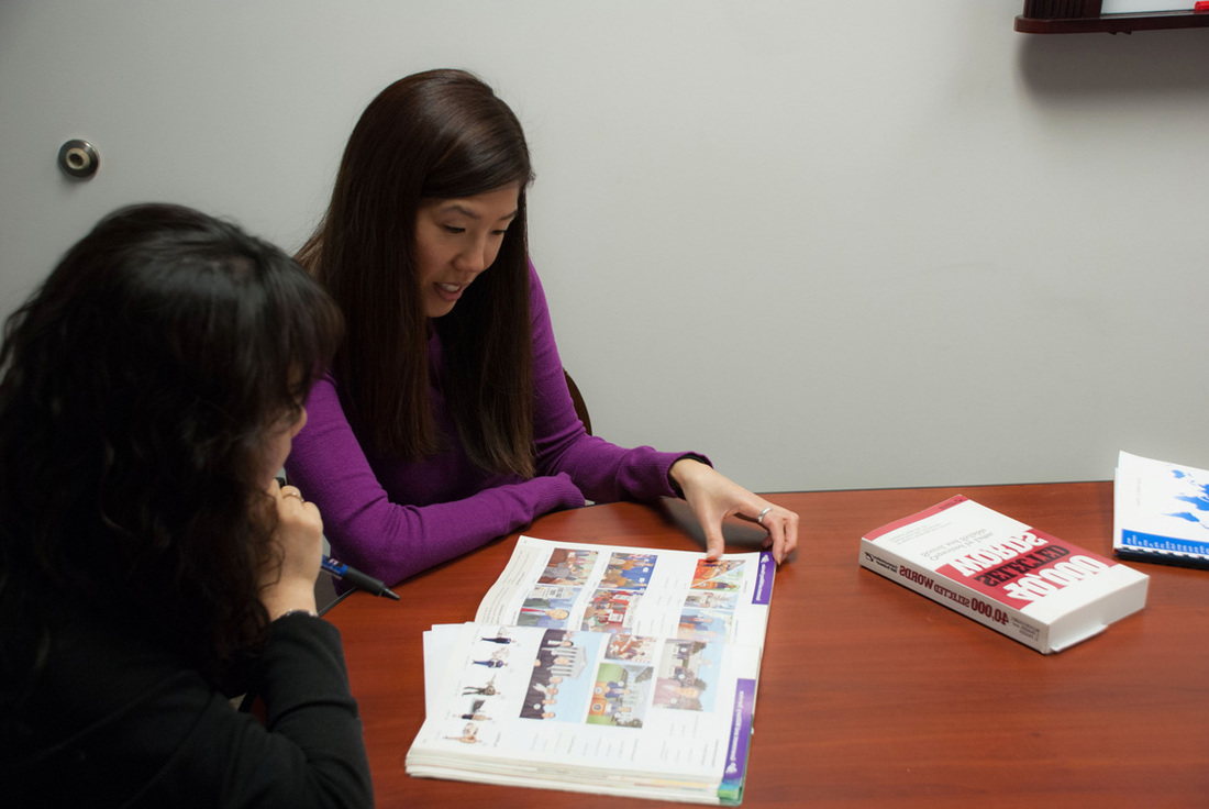 Instructor teaching student new English vocabulary